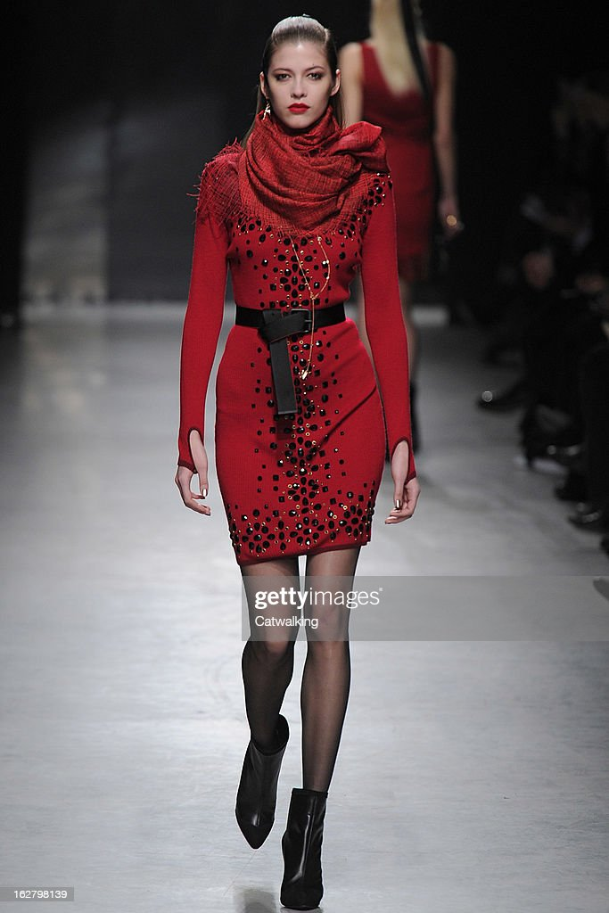 A model walks the runway at the Alexis Mabille Autumn Winter 2013 fashion show during Paris Fashion Week on February 27, 2013 in Paris, France.
