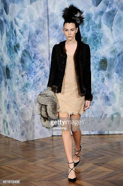 A model walks the runway at the Alexis Mabille Autumn Winter 2014 fashion show during Paris Haute Couture Fashion Week on July 7 2014 in Paris France