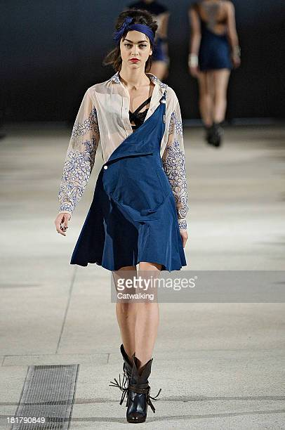 A model walks the runway at the Alexis Mabille Spring Summer 2014 fashion show during Paris Fashion Week on September 25 2013 in Paris France