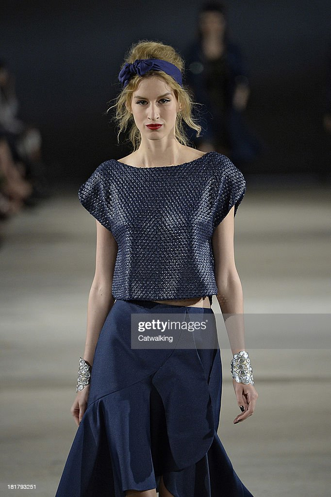 A model walks the runway at the Alexis Mabille Spring Summer 2014 fashion show during Paris Fashion Week on September 25, 2013 in Paris, France.