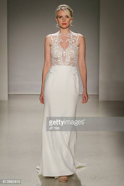 A model walks the runway at the Alfred Angelo Spring 2017 Bridal Show with Disney Weddings at EZ Studios on October 5 2016 in New York City
