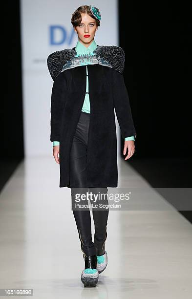 A model walks the runway at the Alina Bianca Ciobotaru for the Domus Academy Collective Show during MercedesBenz Fashion Week Russia Fall/Winter...