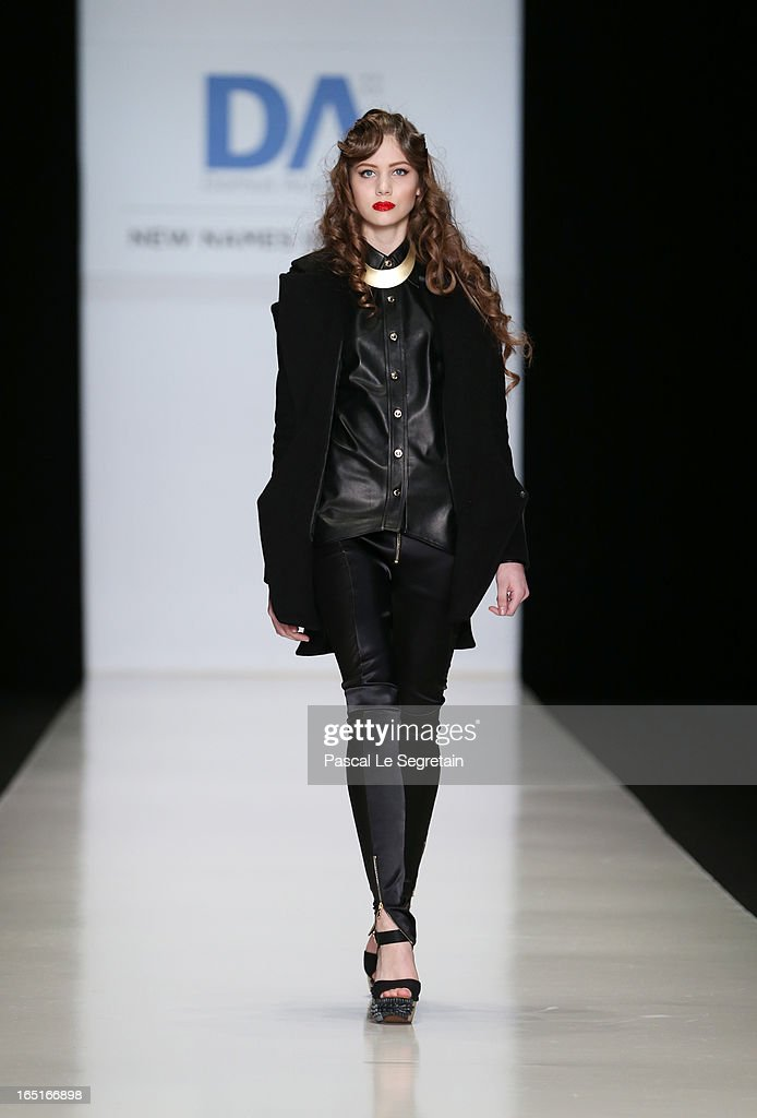 A model walks the runway at the Alina Bianca Ciobotaru (Romania) for the Domus Academy Collective Show during Mercedes-Benz Fashion Week Russia Fall/Winter 2013/2014 at Manege on April 1, 2013 in Moscow, Russia.