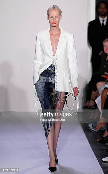 A model walks the runway at the Altuzarra fashion show during MercedesBenz Fashion Week Spring 2014 at Industria Superstudio on September 7 2013 in...