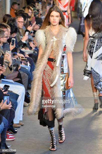 A model walks the runway at the Altuzarra Spring Summer 2018 fashion show during Paris Fashion Week on September 30 2017 in Paris France