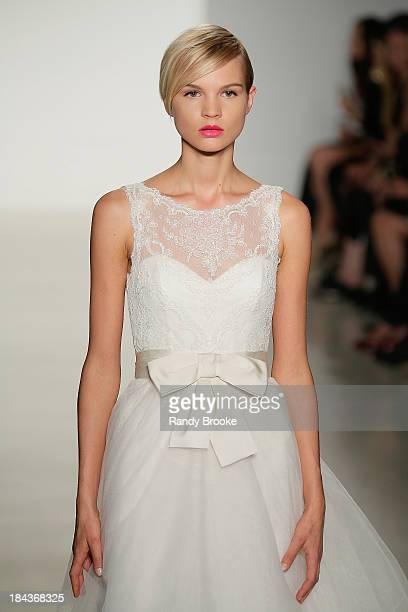 A model walks the runway at the Amsale Fall 2014 Bridal collection show at EZ Studios on October 12 2013 in New York City