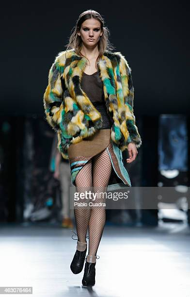 A model walks the runway at the Ana Locking show during Mercedes Benz Madrid Fashion Week Fall/Winter 2015/16 at Ifema on February 9 2015 in Madrid...