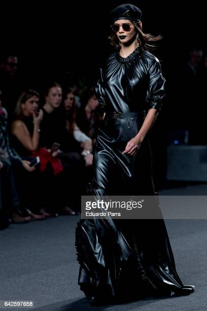 A model walks the runway at the Ana Locking show during the MercedesBenz Madrid Fashion Week Autumn/Winter 2017 at Ifema on February 18 2017 in...