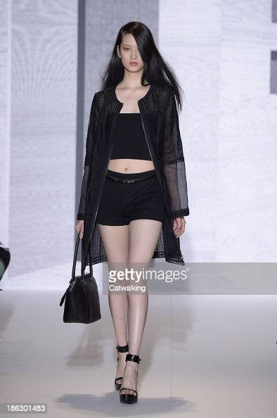 A model walks the runway at the Andrew GN Spring Summer 2014 fashion show during Paris Fashion Week on September 29 2013 in Paris France