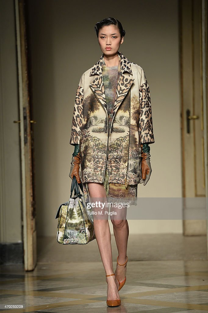 A model walks the runway at the Angelo Marani - Show during Milan Fashion Week Womenswear Autumn/Winter 2014 on February 19, 2014 in Milan, Italy.