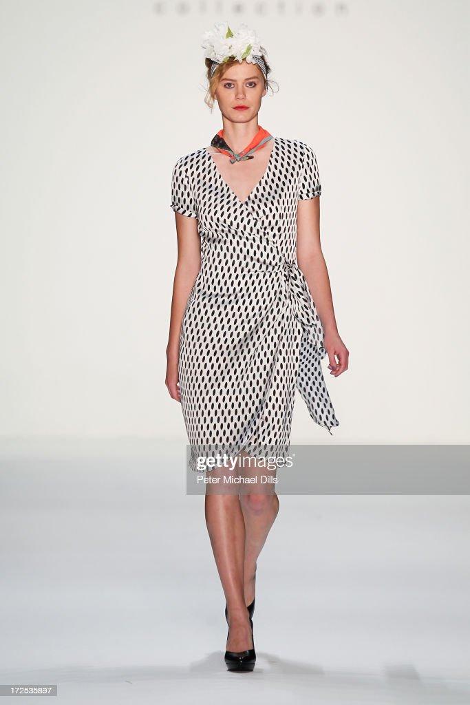 A model walks the runway at the Anja Gockel show during Mercedes-Benz Fashion Week Spring/Summer 2014 at Brandenburg Gate on July 3, 2013 in Berlin, Germany.