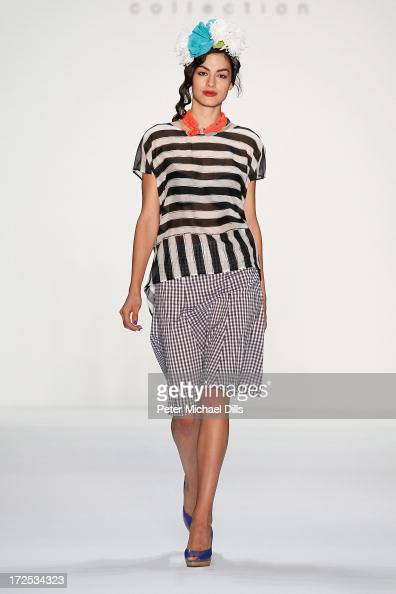 A model walks the runway at the Anja Gockel show during the MercedesBenz Fashion Week Spring/Summer 2014 at the Brandenburg Gate on July 3 2013 in...