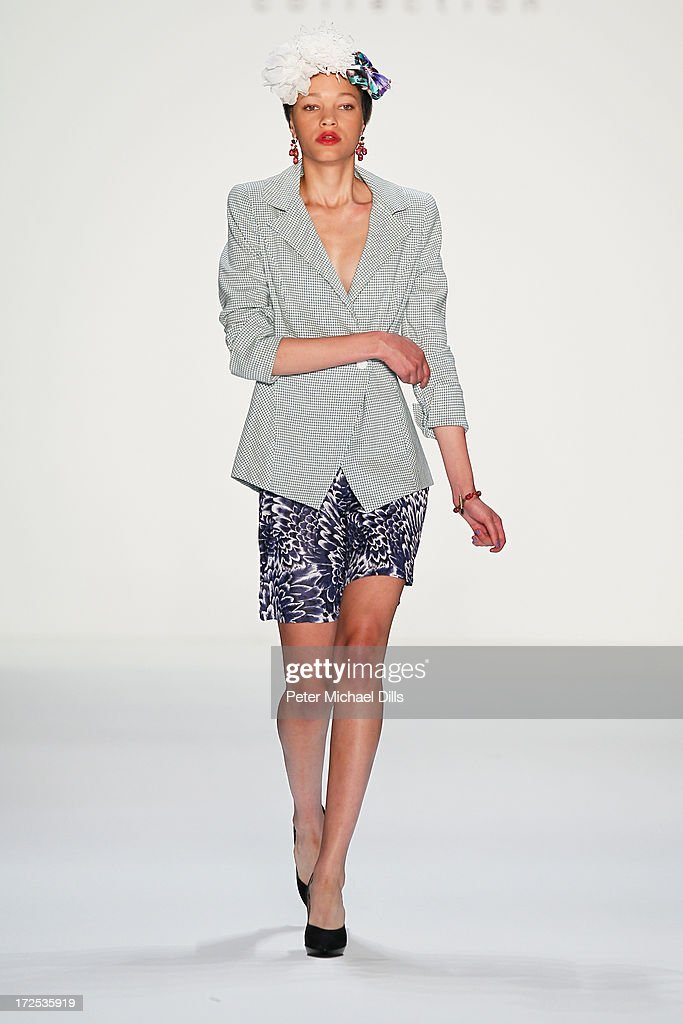 A model walks the runway at the Anja Gockel show during the Mercedes-Benz Fashion Week Spring/Summer 2014 at the Brandenburg Gate on July 3, 2013 in Berlin, Germany.
