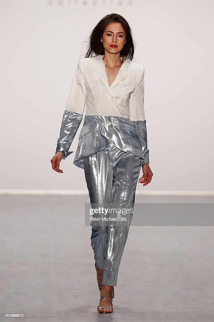 A model walks the runway at the Anja Gockel show during the MercedesBenz Fashion Week Spring/Summer 2015 at Erika Hess Eisstadion on July 9 2014 in...