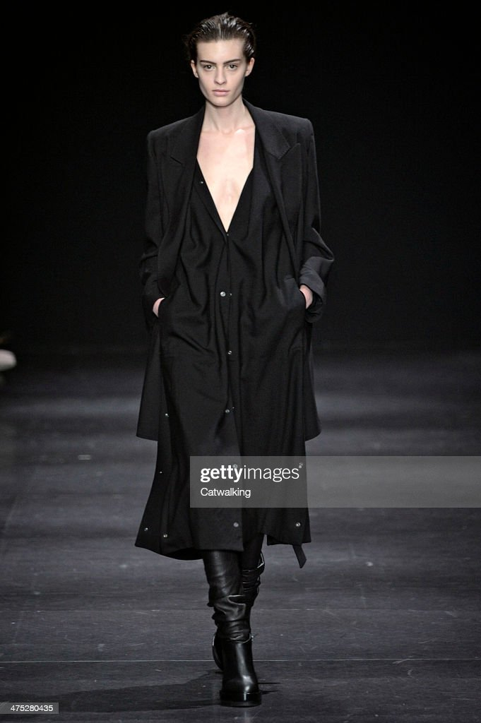A model walks the runway at the Ann Demeulemeester Autumn Winter 2014 fashion show during Paris Fashion Week on February 27 2014 in Paris France