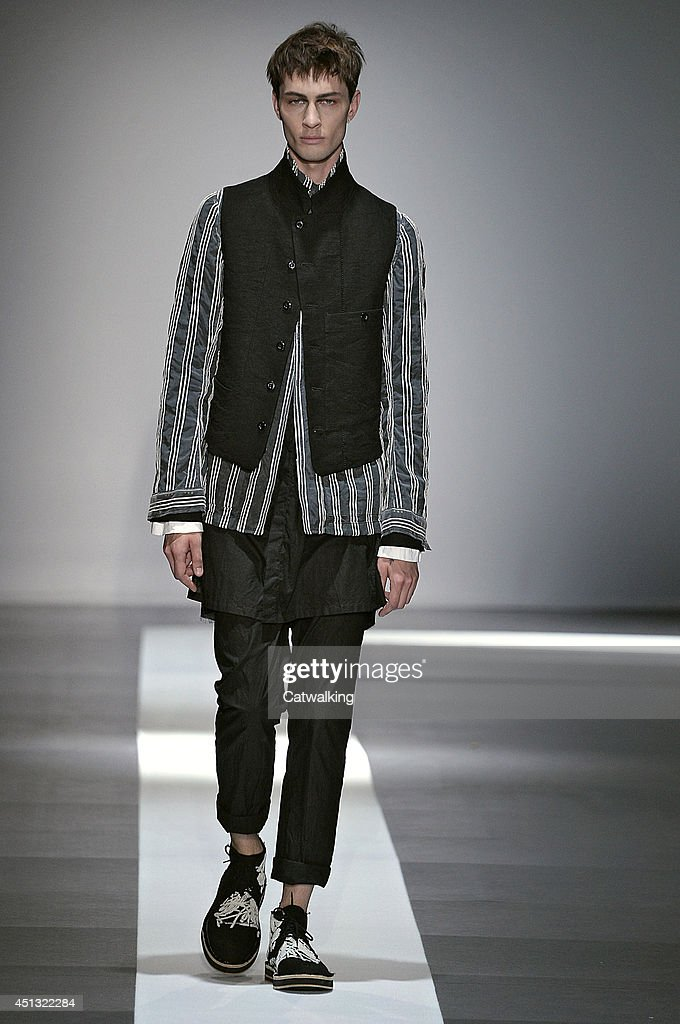 A model walks the runway at the Ann Demeulemeester Spring Summer 2015 fashion show during Paris Menswear Fashion Week on June 27, 2014 in Paris, France.