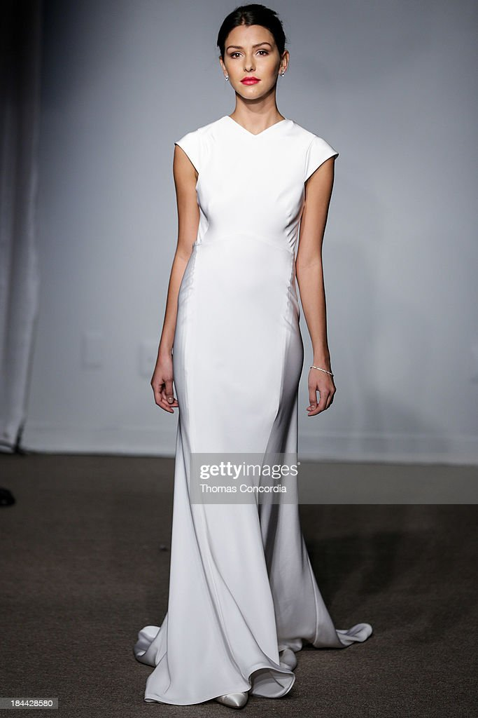 A model walks the runway at the Anna Maier / Ulla-Maija Couture Fall 2014 Bridal collection show at the Hilton New York on October 13, 2013 in New York City.