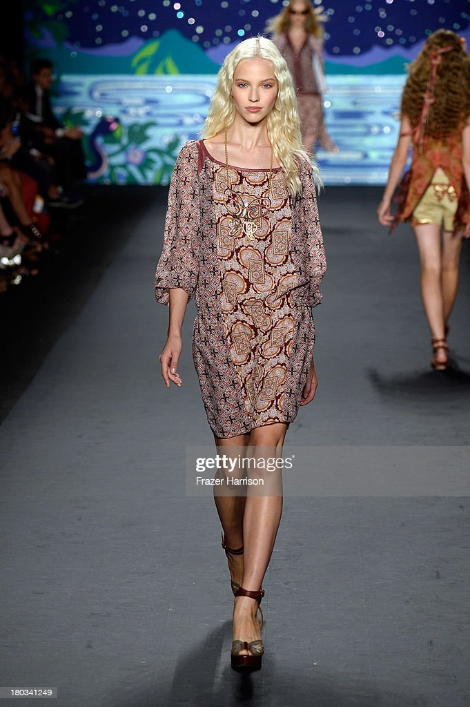 A model walks the runway at the Anna Sui fashion show during Mercedes-Benz Fashion Week Spring 2014 at The Theatre at Lincoln Center on September 11, 2013 in New York City.