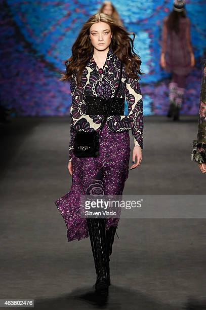 A model walks the runway at the Anna Sui fashion show during MercedesBenz Fashion Week Fall at The Theatre at Lincoln Center on February 18 2015 in...