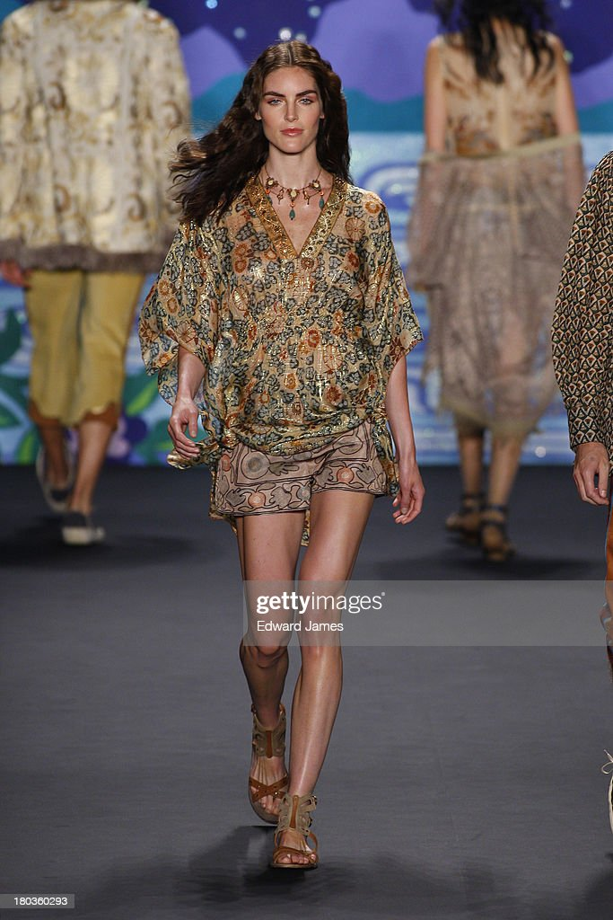 A model walks the runway at the Anna Sui show during Spring 2014 Mercedes-Benz Fashion Week at The Theatre at Lincoln Center on September 11, 2013 in New York City.