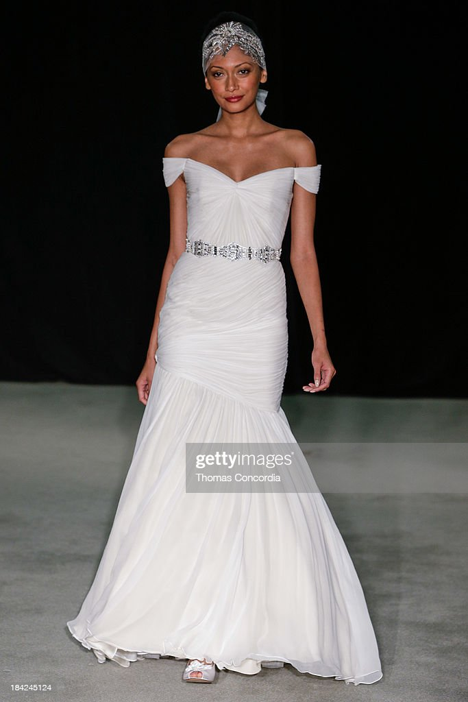 A model walks the runway at the Anne Barge Fall 2014 Bridal collection show at The London Hotel on October 12, 2013 in New York City.