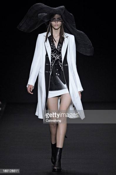 A model walks the runway at the Anne Demeulemeester Spring Summer 2014 fashion show during Paris Fashion Week on September 26 2013 in Paris France