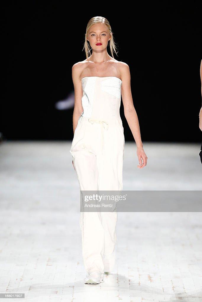 A model walks the runway at the Anne Valerie Hash show during Mercedes-Benz Fashion Days Zurich 2013 on November 14, 2013 in Zurich, Switzerland.
