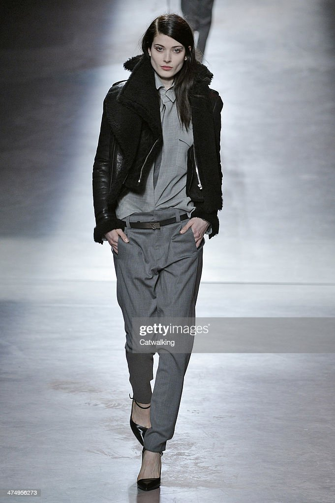A model walks the runway at the Anthony Vaccerello Autumn Winter 2014 fashion show during Paris Fashion Week on February 25, 2014 in Paris, France.