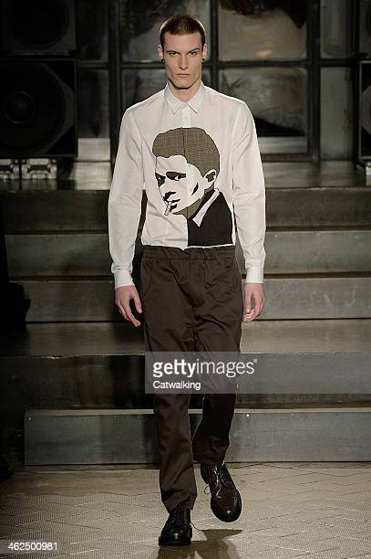 A model walks the runway at the Antonio Marras Autumn Winter 2014 fashion show during Milan Menswear Fashion Week on January 13 2014 in Milan Italy