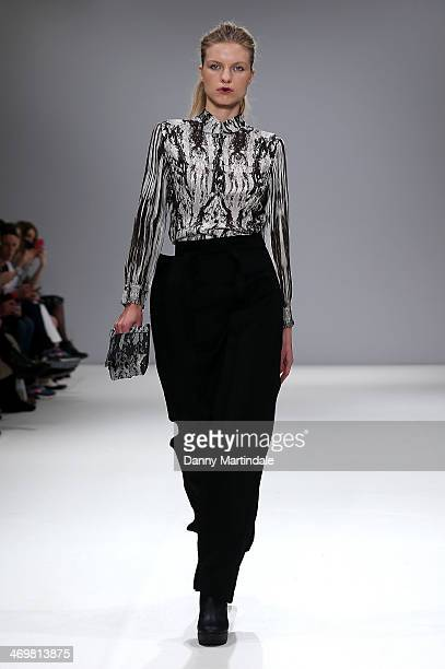 A model walks the runway at the Apu Jan show at the Fashion Scout venue during London Fashion Week AW14 at Freemasons Hall on February 16 2014 in...