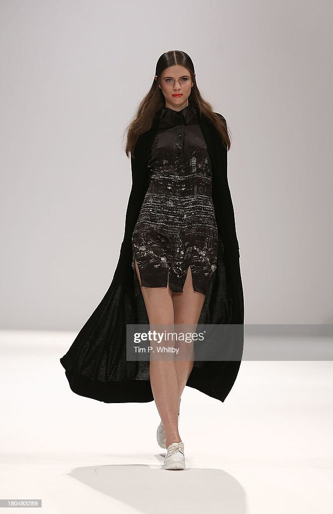 A model walks the runway at the Apu Jan show during at the Fashion Scout venue during London Fashion Week SS14 at Freemasons Hall on September 13, 2013 in London, England.