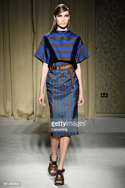 A model walks the runway at the AquilanoRimondi Spring Summer 2014 fashion show during Milan Fashion Week on September 21 2013 in Milan Italy