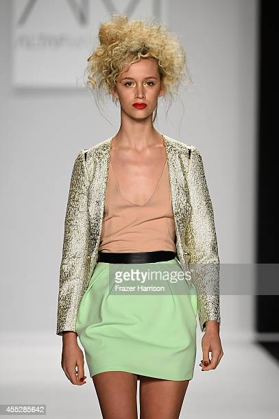 A model walks the runway at the Art Hearts fashion show presented by AIDS Healthcare Foundation during MercedesBenz Fashion Week Spring 2015 at The...