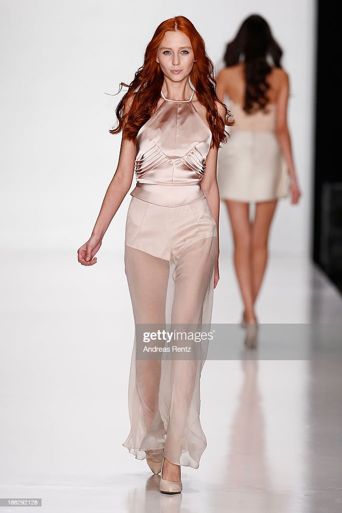 A model walks the runway at the ART Square show during MercedesBenz Fashion Week Russia S/S 2014 on October 30 2013 in Moscow Russia