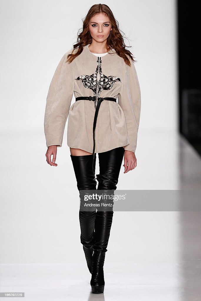 A model walks the runway at the ART Square show during Mercedes-Benz Fashion Week Russia S/S 2014 on October 30, 2013 in Moscow, Russia.