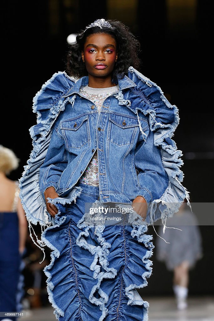 A model walks the runway at the Ashish show at London Fashion Week AW14 at Tate Modern on February 17, 2014 in London, England.