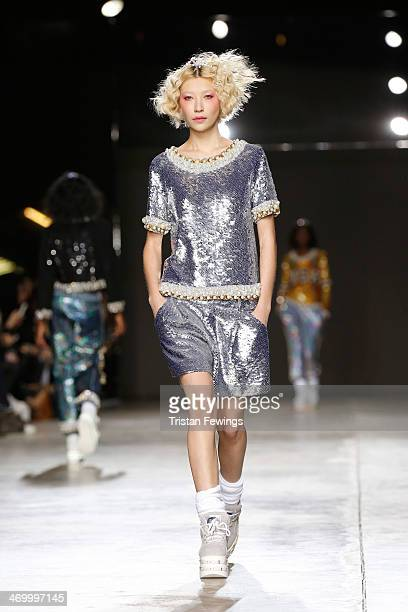 A model walks the runway at the Ashish show at London Fashion Week AW14 at Tate Modern on February 17 2014 in London England
