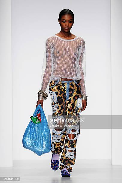 A model walks the runway at the Ashish show during London Fashion Week SS14 at BFC Courtyard Showspace on September 14 2013 in London England