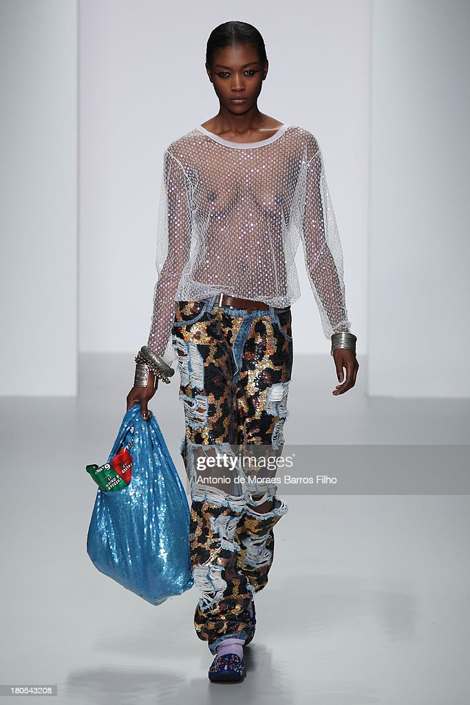 A model walks the runway at the Ashish show during London Fashion Week SS14 at BFC Courtyard Showspace on September 14, 2013 in London, England.