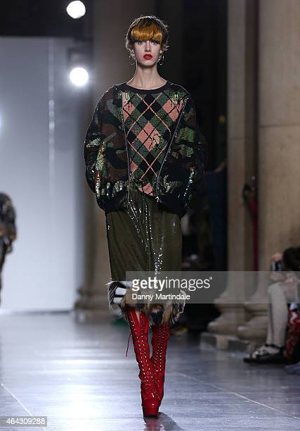 A model walks the runway at the Ashish show during London Fashion Week Fall/Winter 2015/16 at TopShop Show Space on February 24 2015 in London England
