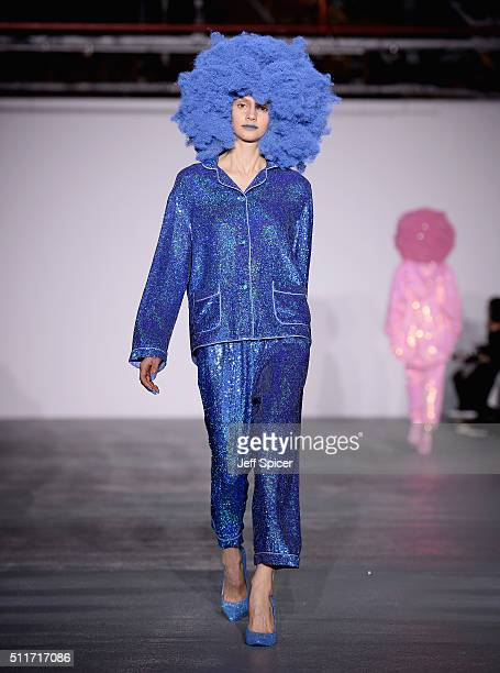 A model walks the runway at the Ashish show during London Fashion Week Autumn/Winter 2016/17 at Brewer Street Car Park on February 22 2016 in London...