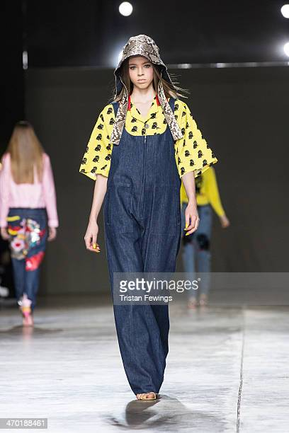 A model walks the runway at the Ashley Williams show during Fashion East at London Fashion Week AW14 at Tate Modern on February 18 2014 in London...