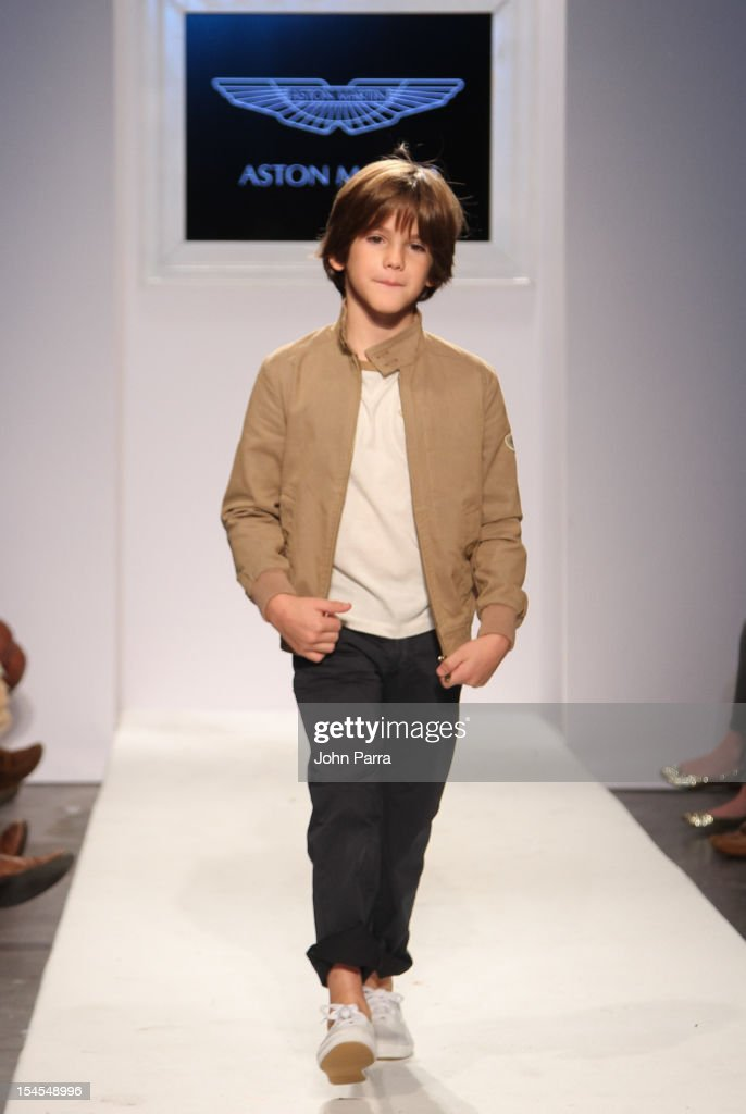 A model walks the runway at the Aston Martin show during Petite Parade NY Kids Fashion Week In Collaboration With VOGUEbambini - Day 2 at Industria Superstudio on October 21, 2012 in New York City.