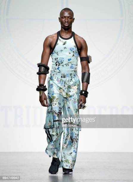 A model walks the runway at the Astrid Andersen show during the London Fashion Week Men's June 2017 collections on June 11 2017 in London England