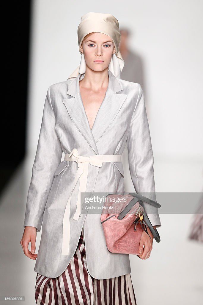 A model walks the runway at the Atelier Galetsky show during Mercedes-Benz Fashion Week Russia S/S 2014 on October 30, 2013 in Moscow, Russia.