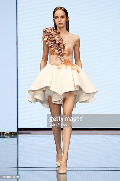 A model walks the runway at the Atelier Krikor Jabotain show as part of the Talents Fashion show during the Vogue Fashion Dubai Experience 2015 at...