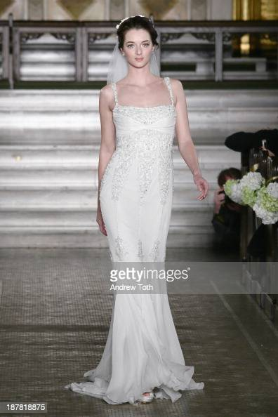 A model walks the runway at the Atelier Pronovias 2014 Show at St James Church on November 12 2013 in New York City