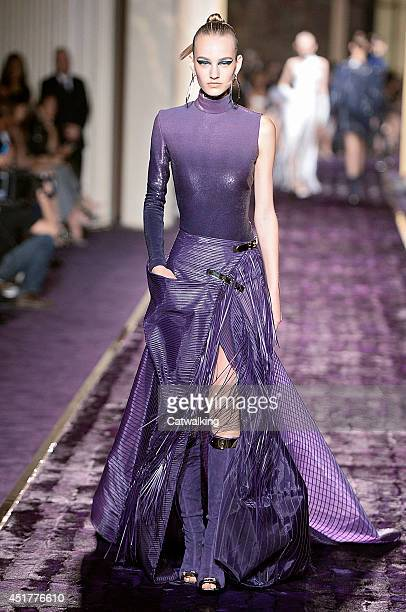 A model walks the runway at the Atelier Versace Autumn Winter 2014 fashion show during Paris Haute Couture Fashion Week on July 6 2014 in Paris France