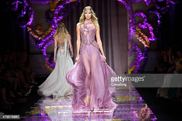A model walks the runway at the Atelier Versace Autumn Winter 2015 fashion show during Paris Haute Couture Fashion Week on July 5 2015 in Paris France