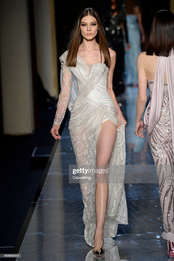 A model walks the runway at the Atelier Versace Spring Summer 2014 fashion show during Paris Haute Couture Fashion Week on January 19, 2014 in Paris, France.